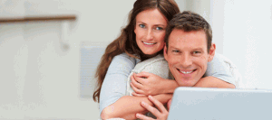 Image Showing Engaged Couple Getting a Quote for Wedding Insurance Online